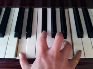 I know what to do at the piano: I put my fingers on the keys, right? Do I need music lessons for that?